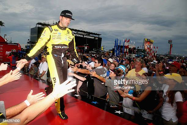 Paul Menard, driver of the Duracell/Menards Chevrolet, shakes fans' hands during driver introductions prior to the NASCAR Sprint Cup Series Coke Zero...