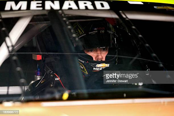 Paul Menard, driver of the Menard's / Duracell Chevrolet, sits in his car in the garage area during practice for the NASCAR Sprint Cup Series Bank of...