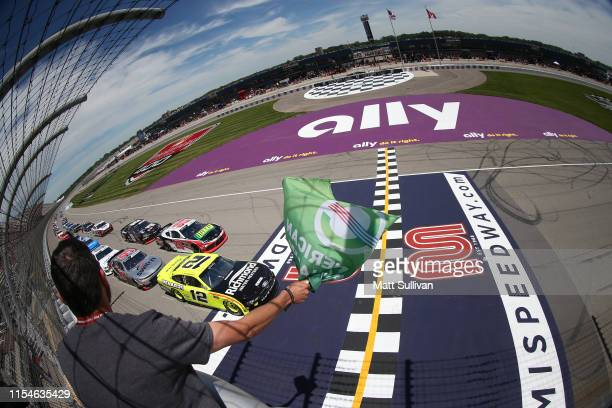 Paul Menard driver of the Menards/Richmond Ford takes the green flag to start the NASCAR Xfinity Series LTi Printing 250 at Michigan International...