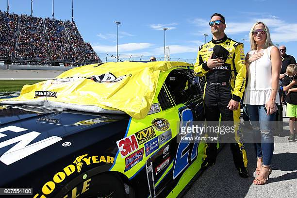 Paul Menard, driver of the Moen/Menards Chevrolet, stands for the national anthem with his wife Jennifer during the NASCAR Sprint Cup Series Teenage...