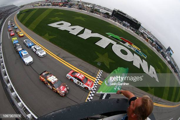 Paul Menard driver of the Motorcraft/Quick Lane Tire Auto Center Ford leads the field at the start of the Monster Energy NASCAR Cup Series Advance...