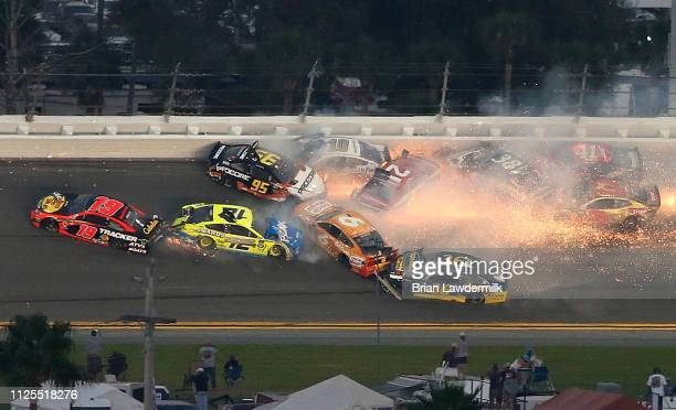 Paul Menard driver of the Motorcraft/Quick Lane Tire Auto Center Ford wrecks during the Monster Energy NASCAR Cup Series 61st Annual Daytona 500 at...