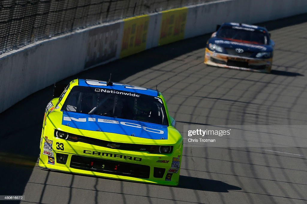 Paul Menard, driver of the #33 Nibco/Menards Chevrolet, leads Sam Hornish Jr., driver of the #20 Sun Energy 1 Toyota, in the final laps of the NASCAR Nationwide Series Ollie's Bargain Outlet 250 at Michigan International Speedway on June 14, 2014 in Brooklyn, Michigan.