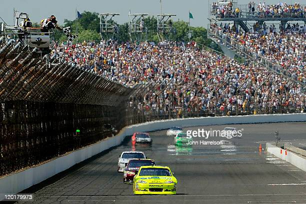 Paul Menard, driver of the NIBCO/Menards Chevrolet, takes the checkered flag as he crosses the finish line to win the NASCAR Sprint Cup Series...