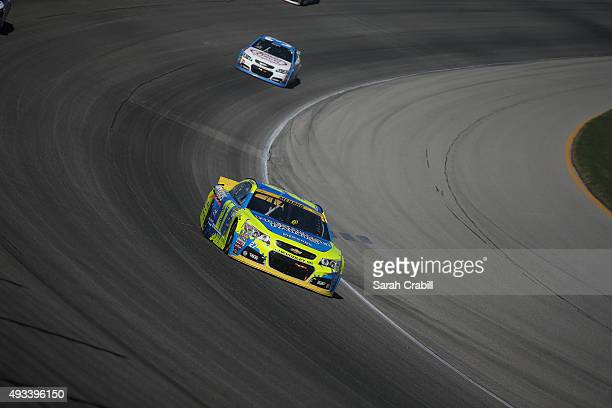 Paul Menard driver of the Pittsburgh Paints/Menards Chevrolet leads a pack of cars during the NASCAR Sprint Cup Series myAFibRiskcom 400 at...