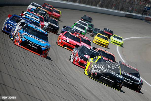 Paul Menard driver of the Richmond/Menards Chevrolet leads a pack of cars during the NASCAR XFINITY Series Menards 250 at Michigan International...
