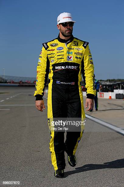 Paul Menard driver of the SYLVANIA/Menards Chevrolet stands on the grid during qualifying for the NASCAR Sprint Cup Series Pure Michigan 400 at...