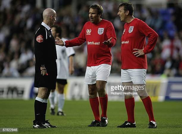 Paul Merson and Matt Le Tisser of England argue with referee Dermot Gallagher during the Legends match between England and Germany at The Madejski...