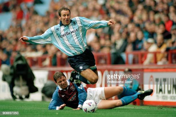 Paul Merson of Middlesbrough is brought down by Alan Thompson of Aston Villa during an FA Carling Premiership match at Villa Park on August 23 1998...