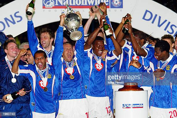 Paul Merson of Portsmouth lifts the trophy up as his teammates celebrate winning the league title after the Nationwide League Division One match...