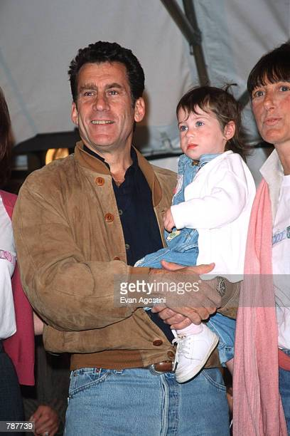 Paul Michael Glaser holds daughter Zoe at the Kids For Kids AIDS Benefit April 25 1999 in New York City The event organized by Elizabeth Glaser...