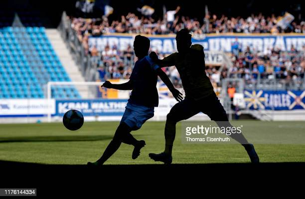 Paul Milde of Chemnitz is challenged by Daniele Gabriele of Jena during the 3. Liga match between Chemnitzer FC and FC Carl Zeiss Jena at Stadion an...
