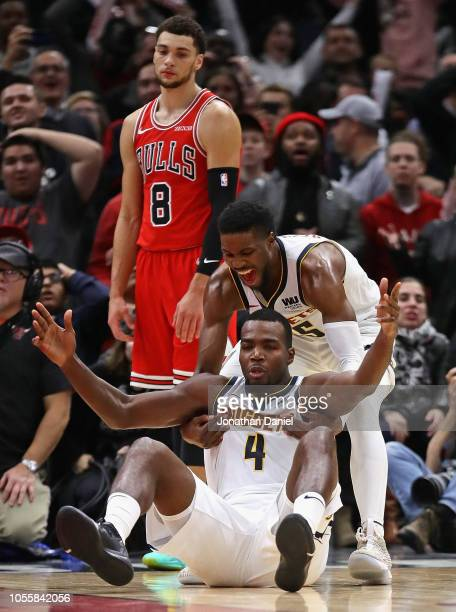 Paul Millsap and Malik Beasley of the Denver Nuggets celebrate after Millsap hit the game winning shot as Zach LaVine of the Chicago Bulls watches at...