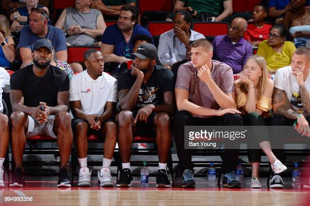 Paul Millsap and Nikola Jokic of the Denver Nuggets sit court side as they play against the Milwaukee Bucks during the 2018 Las Vegas Summer League...