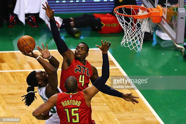 Paul Millsap of the Atlanta Hawks and Al Horford of the Atlanta Hawks defend a shot by Jae Crowder of the Boston Celtics during the first quarter of...