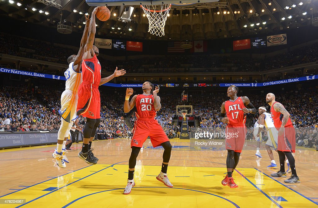 Paul Millsap #4 of the Atlanta Hawks grabs the rebound against the Golden State Warriors on March 7, 2014 at Oracle Arena in Oakland, California.