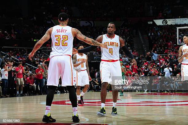 Paul Millsap of the Atlanta Hawks high fives Mike Scott of the Atlanta Hawks against the Boston Celtics in Game Five of the Eastern Conference...