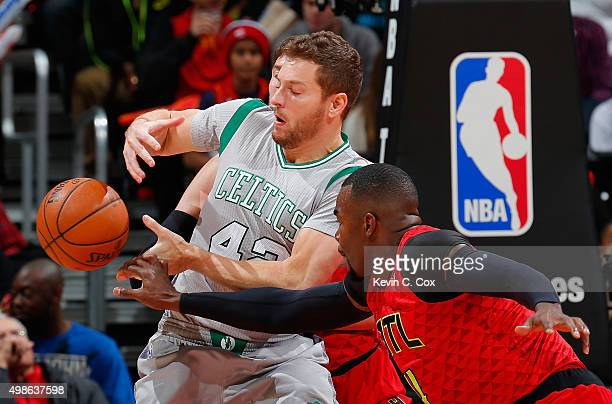 Paul Millsap of the Atlanta Hawks knocks the ball out of the hands of David Lee of the Boston Celtics at Philips Arena on November 24 2015 in Atlanta...