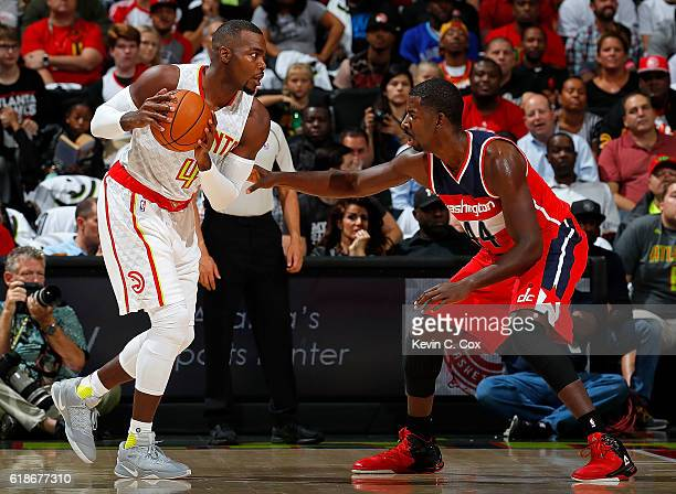 Paul Millsap of the Atlanta Hawks looks to drive against Andrew Nicholson of the Washington Wizards at Philips Arena on October 27 2016 in Atlanta...