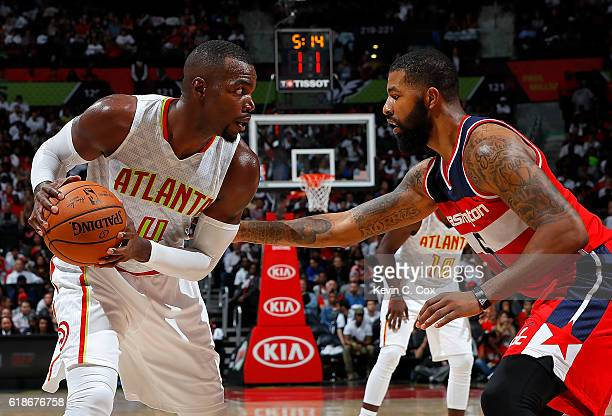 Paul Millsap of the Atlanta Hawks looks to drive against Markieff Morris of the Washington Wizards at Philips Arena on October 27 2016 in Atlanta...