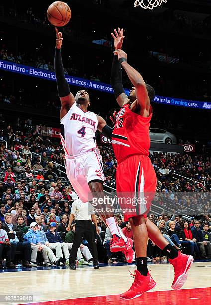 Paul Millsap of the Atlanta Hawks puts up a shot against the Portland Trail Blazers on January 30 2015 at Philips Arena in Atlanta Georgia NOTE TO...