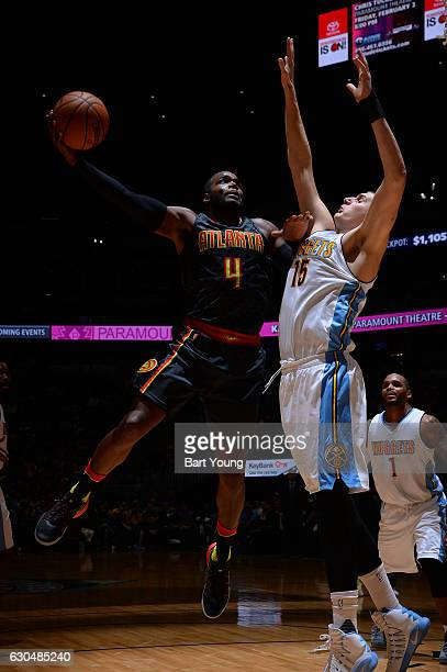 Paul Millsap of the Atlanta Hawks shoots the ball against Nikola Jokic of the Denver Nuggets during the game on December 23 2016 at the Pepsi Center...