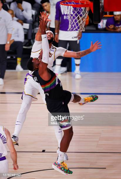 Paul Millsap of the Denver Nuggets and Anthony Davis of the Los Angeles Lakers fight for a rebound during the third quarter in Game Three of the...