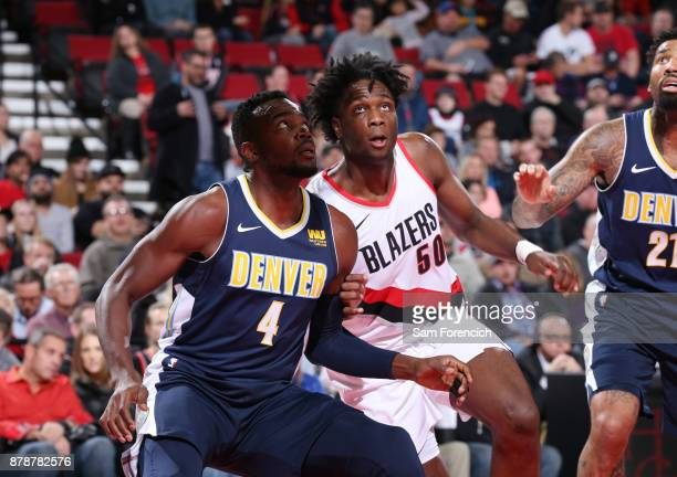 Paul Millsap of the Denver Nuggets and Caleb Swanigan of the Portland Trail Blazers await the ball during the game on November 13 2017 at the Moda...