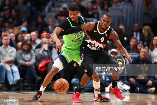 Paul Millsap of the Denver Nuggets and Jarrett Culver of the Minnesota Timberwolves compete for the ball at Pepsi Center on February 23 2020 in...