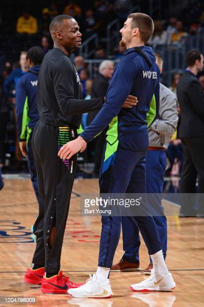 Paul Millsap of the Denver Nuggets and Juan Hernangomez of the Minnesota Timberwolves talk before the game on February 23 2020 at the Pepsi Center in...
