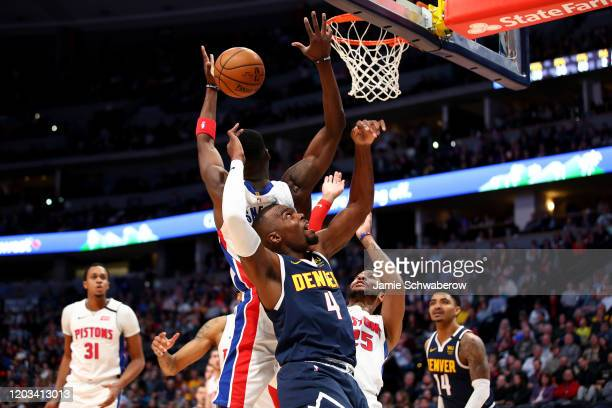 Paul Millsap of the Denver Nuggets and Tony Snell of the Detroit Pistons battle for a rebound at Pepsi Center on February 25 2020 in Denver Colorado...