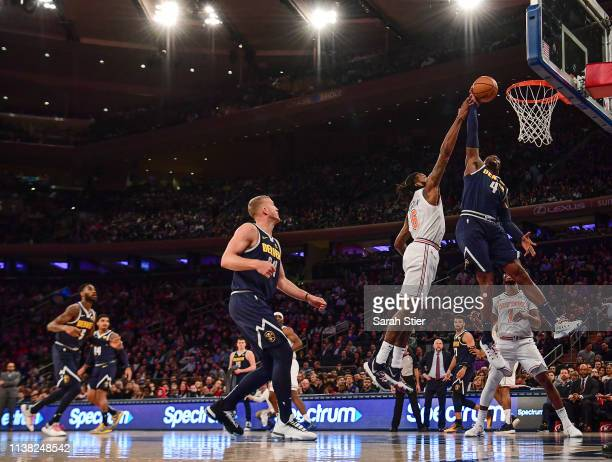 Paul Millsap of the Denver Nuggets attempts a basket against DeAndre Jordan of the New York Knicks during the first half of the game at Madison...