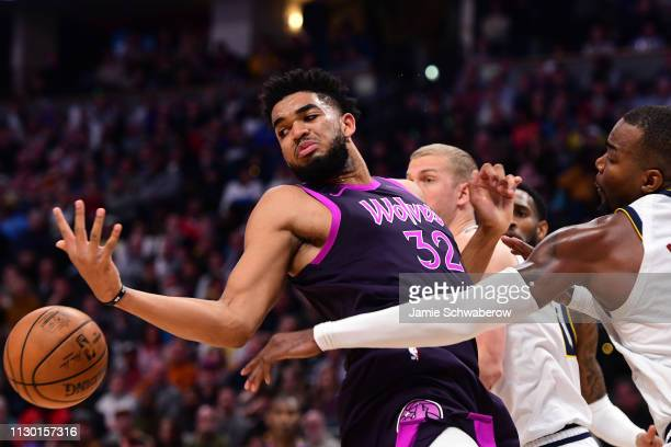 Paul Millsap of the Denver Nuggets defends KarlAnthony Towns of the Minnesota Timberwolves at Pepsi Center on March 12 2019 in Denver Colorado NOTE...