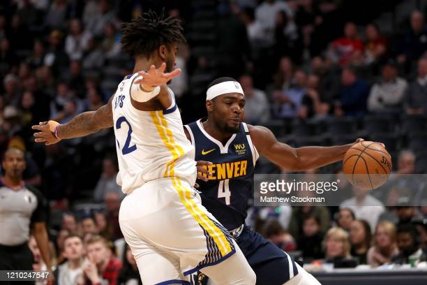 Paul Millsap of the Denver Nuggets drives against Marquese Chriss of the Golden State Warriors in the fourth quarter at the Pepsi Center on March 03...