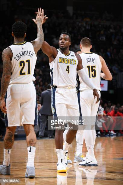 Paul Millsap of the Denver Nuggets gives high five to Wilson Chandler of the Denver Nuggets during the game against the Toronto Raptors on November 1...