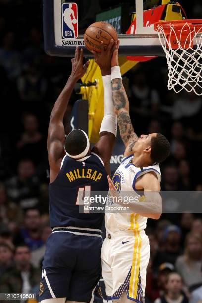 Paul Millsap of the Denver Nuggets goes to the basket against Juan ToscanoAnderson of the Golden State Warriors in the first quarter at the Pepsi...