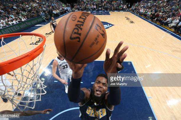 Paul Millsap of the Denver Nuggets goes to the basket against the Memphis Grizzlies on March 17 2018 at FedExForum in Memphis Tennessee NOTE TO USER...