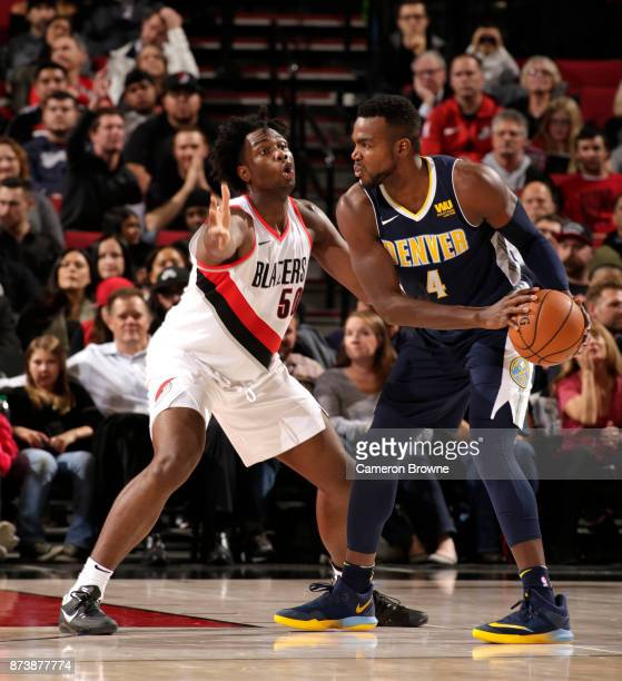 Paul Millsap of the Denver Nuggets handles the ball against Caleb Swanigan of the Portland Trail Blazers on November 13 2017 at the Moda Center in...