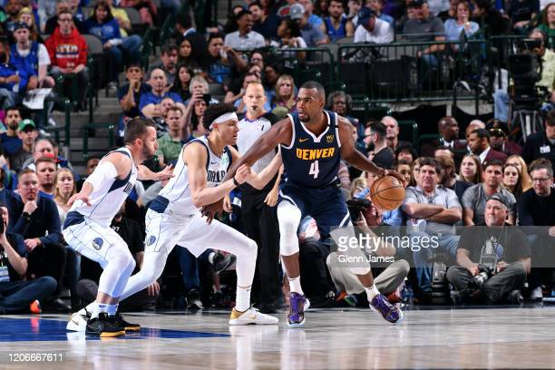 Paul Millsap of the Denver Nuggets handles the ball against the Dallas Mavericks on March 11 2020 at the American Airlines Center in Dallas Texas...