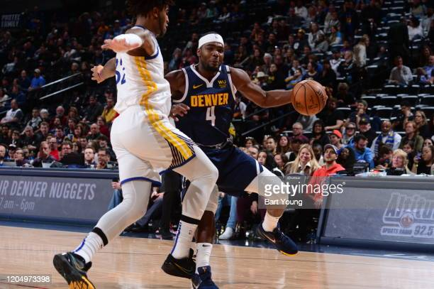 Paul Millsap of the Denver Nuggets handles the ball during a game against the Golden State Warriors on March 3 2020 at the Pepsi Center in Denver...