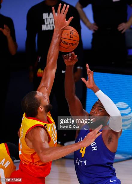 Paul Millsap of the Denver Nuggets has a shot blocked by Rudy Gobert of the Utah Jazz during the fourth quarter in Game Four of the Western...