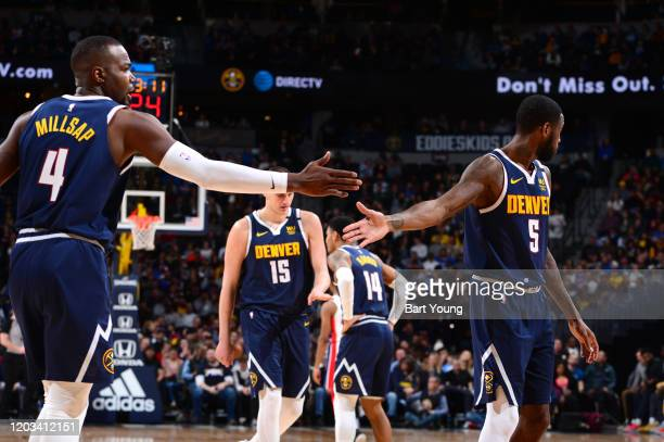 Paul Millsap of the Denver Nuggets highfives Will Barton of the Denver Nuggets against the Detroit Pistons on February 25 2020 at the Pepsi Center in...