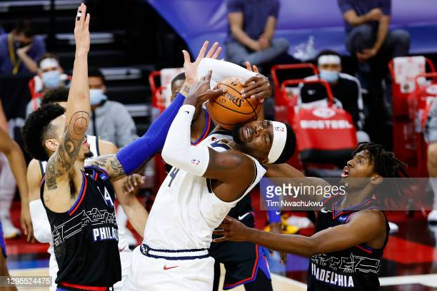Paul Millsap of the Denver Nuggets is guarded by Danny Green and Tyrese Maxey of the Philadelphia 76ers during the first quarter at Wells Fargo...