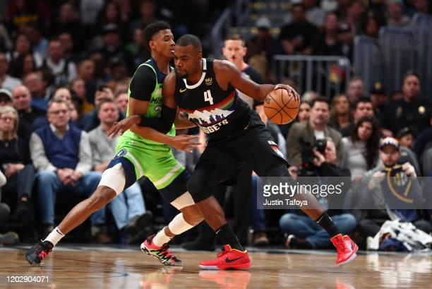 Paul Millsap of the Denver Nuggets is guarded by Jarrett Culver of the Minnesota Timberwolves at Pepsi Center on February 23 2020 in Denver Colorado...