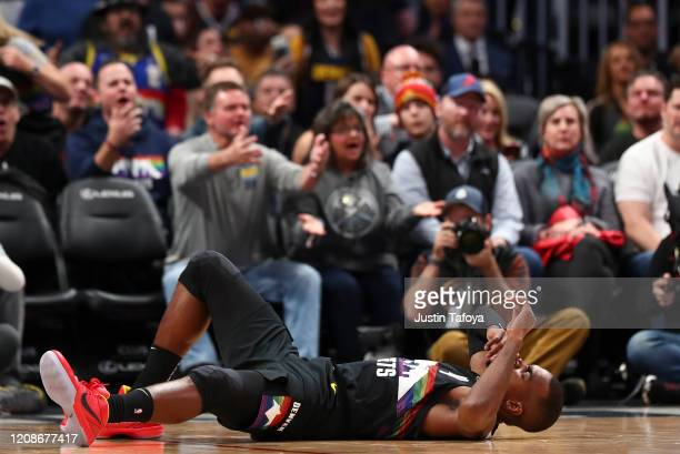 Paul Millsap of the Denver Nuggets is injured on a play during the game against the Minnesota Timberwolves at Pepsi Center on February 23 2020 in...