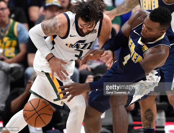 Paul Millsap of the Denver Nuggets knocks the ball away from Ricky Rubio of the Utah Jazz during the second half of the 10696 win by the Jazz at...