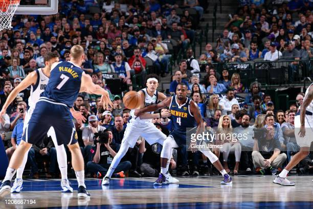 Paul Millsap of the Denver Nuggets plays defense against Justin Jackson of the Dallas Mavericks on March 11 2020 at the American Airlines Center in...