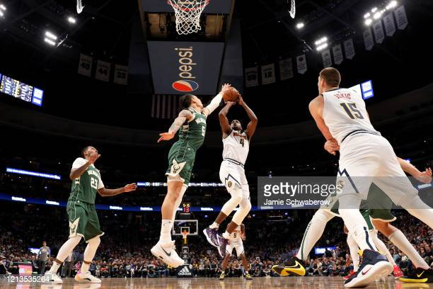 Paul Millsap of the Denver Nuggets shoots over DJ Wilson of the Milwaukee Bucks at Pepsi Center on March 9 2020 in Denver Colorado NOTE TO USER User...