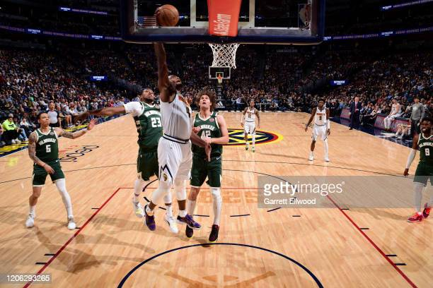 Paul Millsap of the Denver Nuggets shoots the ball against the Milwaukee Bucks on March 09 2020 at the Pepsi Center in Denver Colorado NOTE TO USER...
