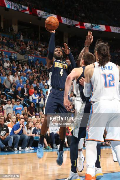 Paul Millsap of the Denver Nuggets shoots the ball against the Oklahoma City Thunder on March 30 2018 at Chesapeake Energy Arena in Oklahoma City...